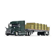 1/64 DCP Volvo VNL 740 Mid-Roof Sleeper in Forest Green with Wilson Flatbed Trai