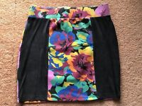 Minkpink Skirt Floral print & black panels.Size L.G/C