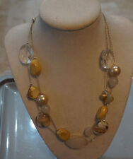 Silver finish double strand necklace with clear, opaque, gold colored scattered