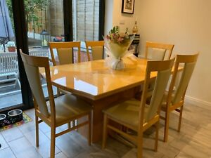 Good quality  Maple Wood veneer Dining table and 6 chairs in good condition.