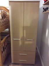 Two door and 2 drawer wardrobe in a light oak and a 3 drawer bedside unit