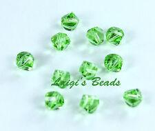 12 Peridot Swarovski #5020 Helix Crystal Beads 4mm