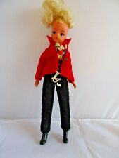 Vintage 1976 blonde Sindy doll (checked top, black trousers & red jacket)