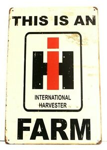This is an International Harvester Farm Tin Poster Rustic Sign Tractor Farmer