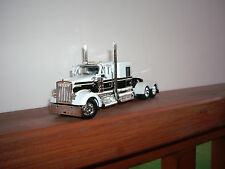 DCP 1/64 WHITE AND BLACK W900 KENWORTH WITH 60'' FLAT TOP SLEEPER