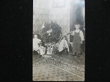 RPPC OF CHRISTMAS TREE & TOYS-CUTE DUTCH GIRL WITH HER DOLLS & FISHING POLE