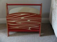 Mid 20th century wood magazine rack with atomic painted pattern