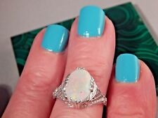 2.55 Ct. Oval Faceted Rainbow Opal Filigree Sterling Silver Ring Free Sizing