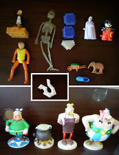 lot figurine Asterix Pif Hercules Daffy Duck Mac Donald Burger King motard Mcdo