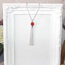 Flapper long silver necklace with burnt orange glass crackle beads and tassel