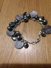 Ladies bracelet New with tags. Grey acrylic charm style.