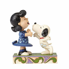 Jim Shore Peanuts 'Agh! I've been kissed by a dog!' Snoopy Kissing Lucy 4055941
