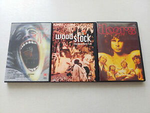 3 DVDs >The Doors, Woodstock -The Director´s Cut- & Pink Floyd: The Wall< Musik!