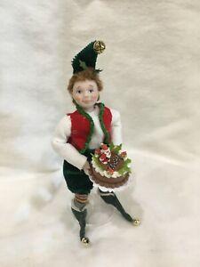 Christmas Elf holding cake