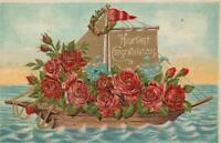 1900's VINTAGE EMBOSSED ROSES SAILING BOAT HEARTIEST CONGRATULATIONS POSTCARD