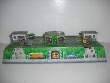 WV tin plate clockwork German bus station toy