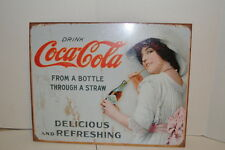 Drink Coca Cola From A Bottle Through A Straw Metal Sign