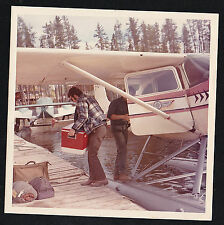 Old Vintage Photograph Man Carrying Ice Chest on Dock Near Seaplane in Water