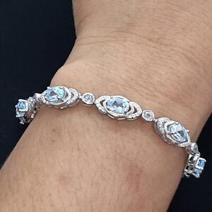 World Class 8.85ctw Swiss Topaz & Diamond Cut White Sapphire 925 Silver Bracelet