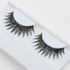 a pair of loaded nightclub makeup exaggerated fashion glitter, fake eyelashes fa