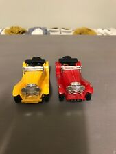 2 X Models of Yesteryear: 1936 SS 100 Jaguar One Yellow One Red