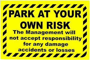 Park at Own Risk. No Responsibility Parking Sign