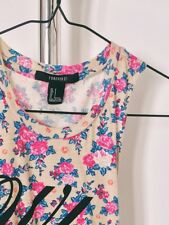 "Forever 21 ""who cares"" floral crop top"