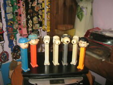 7 Vintage Peanuts Snoopy Lucy  PEZ Candy Dispensers Slovenia with Feet
