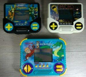 1980s VTG Electronic Handheld Game Lot The Pagemaster, Batman, V Fighter Tested