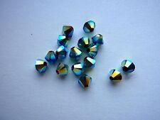 30 Swarovski® Kristall Perlen Xilion Beads 4mm JET AB 2x Art. 5328