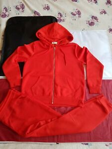 ladies red  papaya   tracksuit size l   size 18