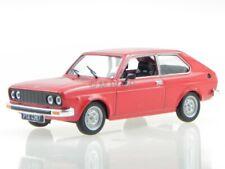 Fiat 128 P red diecast modelcar in showcase 1:43