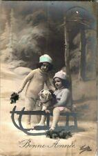 1913. TODDLERS W/ PET PIG ON SLEIGH.  POSTCARD TM13