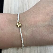 14k yellow gold pearl bead bracelet with star charm set with diamond