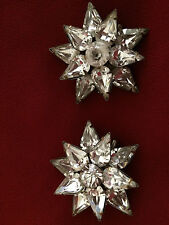 Two matching broaches each with 10 pear shape stones surrounding 1 round stone