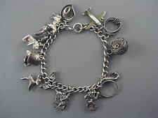 Antique Sterling Silver Charm Bracelet with Unique Antique Charms