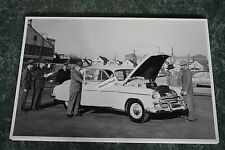 """12 By 18"""" Black & White Picture 1950 Chevrolet Deluxe being evaluated"""
