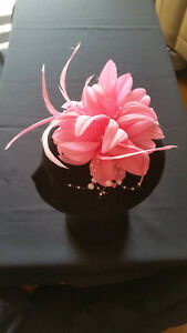 Fascinator -Pink flower and feathers mounted on a clip.
