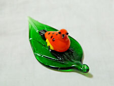 Hand Blown Glass Figure of an Orange Bird On A Glass Elm Leaf