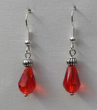 SMALL FACETED RED GLASS DROP EARRINGS WITH SILVER PLATED DETAIL.HOOK
