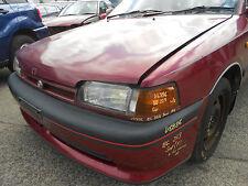 1993 Mazda 323 Sedan LH Head Light S/N# V6886 BI2996