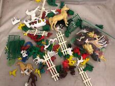 Assorted plastic farm animals and plastic farmland mat - horses, cows, fence