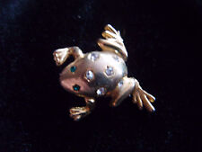 Cute little gold tone metal and diamante frog brooch with green glass eyes