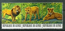 Guinea Stamp: 1977  Lion.  Strip of 3, CTO CV=$10