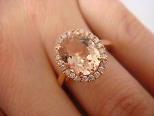 2 CARAT OVAL PEACH MORGANITE AND 0.25 CT T.W. HALO DIAMONDS 14K ROSE GOLD RING