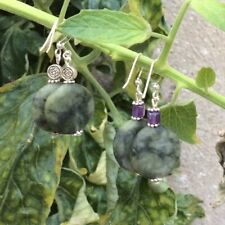Connemara marble and amethyst or celtic bead earrings. Sterling silver wires.