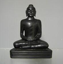 Bouddha en Bois d'ébène sculpté dans la masse.