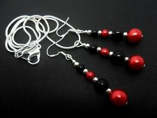A BLACK/RED PEARL BEAD NECKLACE AND EARRING SET  WITH 925 SILVER HOOKS.