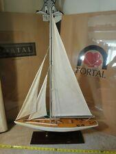 Handmade wooden model sail boat, yacht. Ocean sailing vessel, ship display.