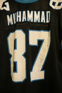 Autographed Carolina Panthers Jersey #87 Muhsin Muhammad, #94 Kindal Moorehead